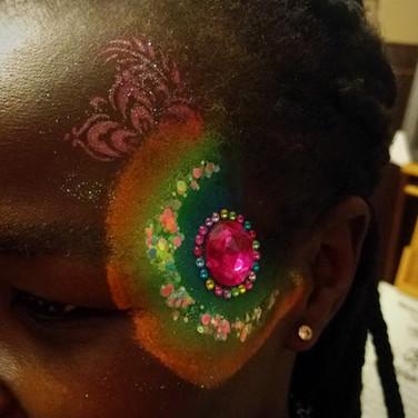 Circular Neon Eye Design Feather Glitter Jewels Cluster | Girl Girls Teen Teens Woman Women Ladies | Facepainting Facepainter Facepainters Facepaint Face Painting Paint Painter Regina SK Saskatchewan