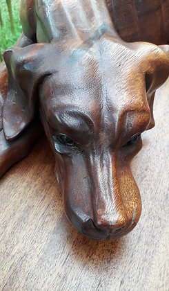 Large carved hardwood recumbent hound