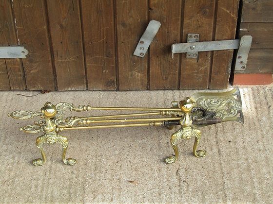 Ball and claw antique brass fire irons and dogs