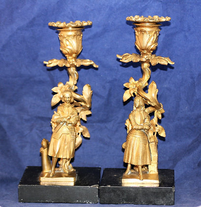A near pair of Bronze Renaissance Figural Candlesticks