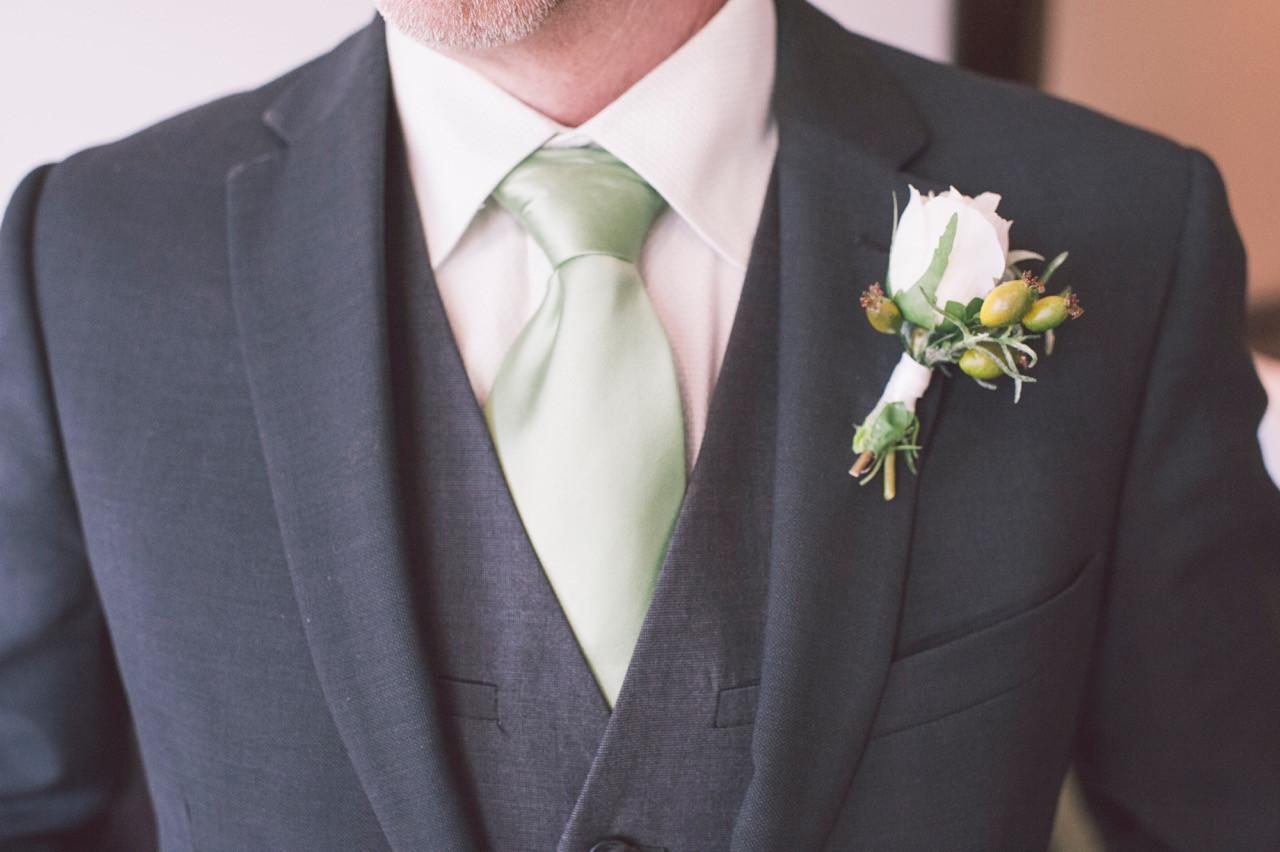 Groom buttonhole flower boutonniere groomsmen ideas suit