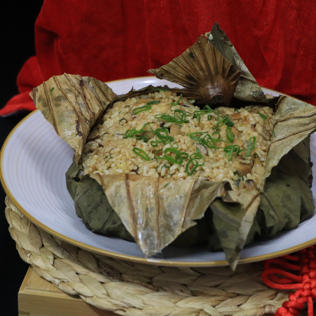 Fried Rice with Steamed Chicken with Chinese Mushroom in Lotus Leaf