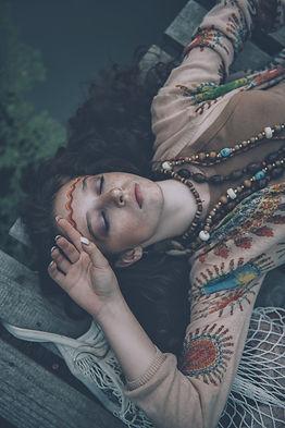 Beautiful hippie girl posing outdoor. Co