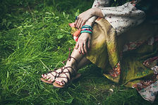 woman legs  on grass in strap flat sand