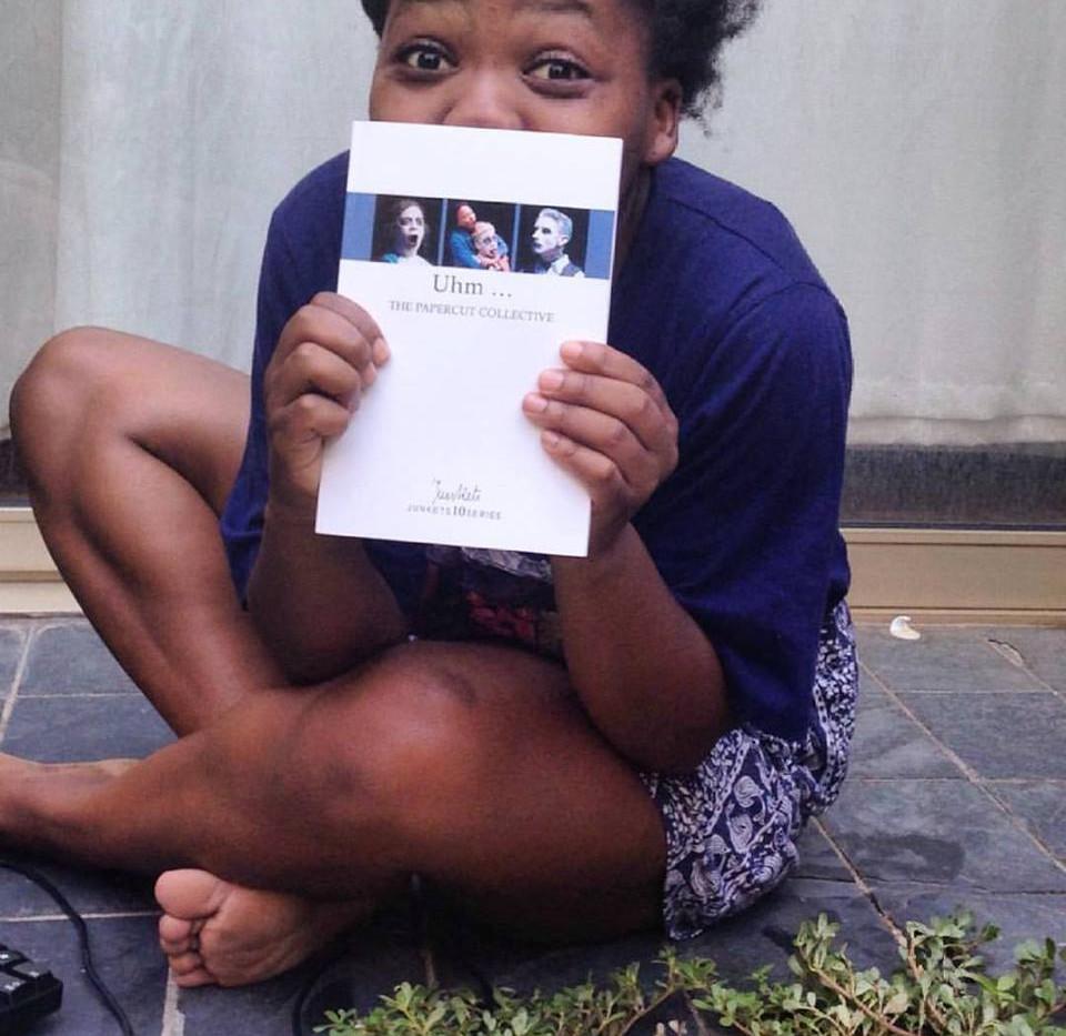Koleka Putuma receives her copy of Uhm .