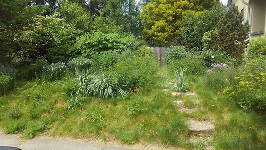 Suburban Garden by J. Mitchell Gardens and Stone