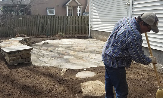 Jim Mitchell working on a patio