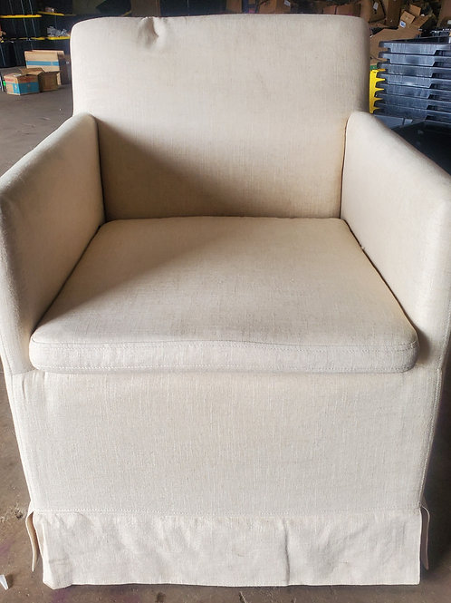 Cream upholstered rolling arm chair
