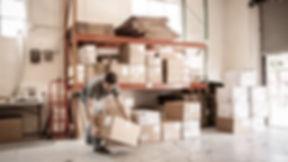 Worker Lifting Cardboard Box_edited_edit