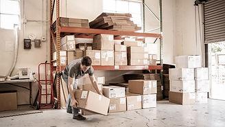Worker Lifting Cardboard Box_edited_edited.jpg