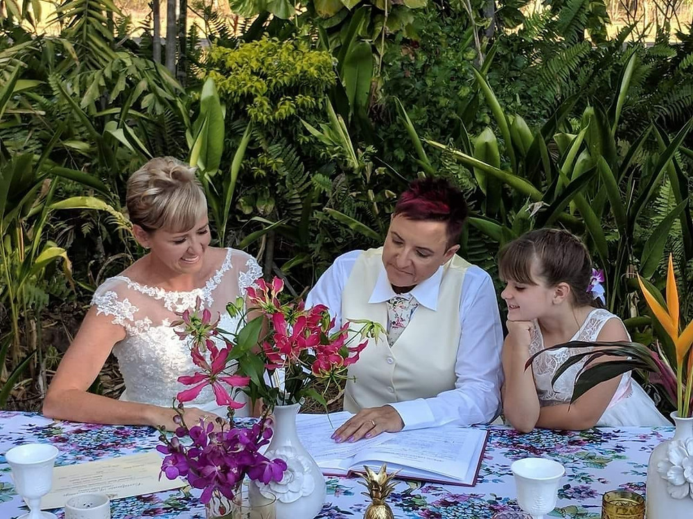 same sex wedding, signing the certificates, family