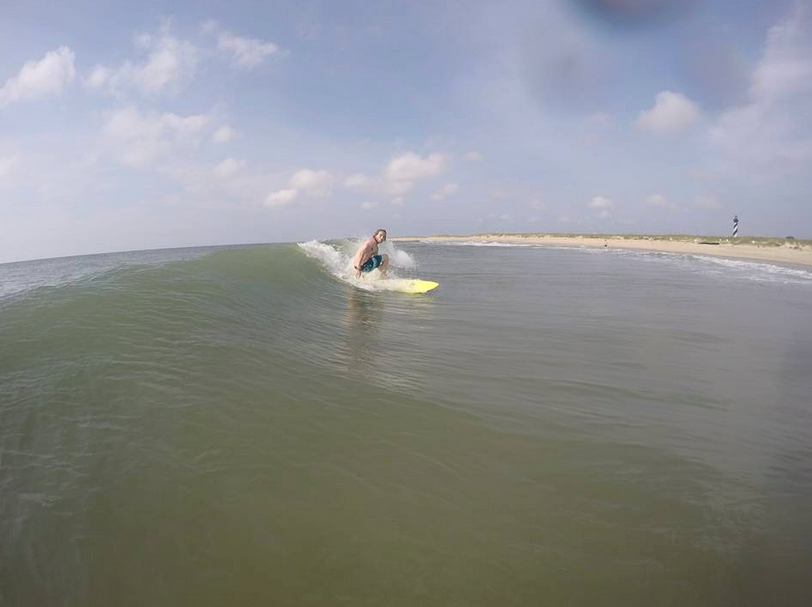 Surfing a small day in Cape Hatteras, NC