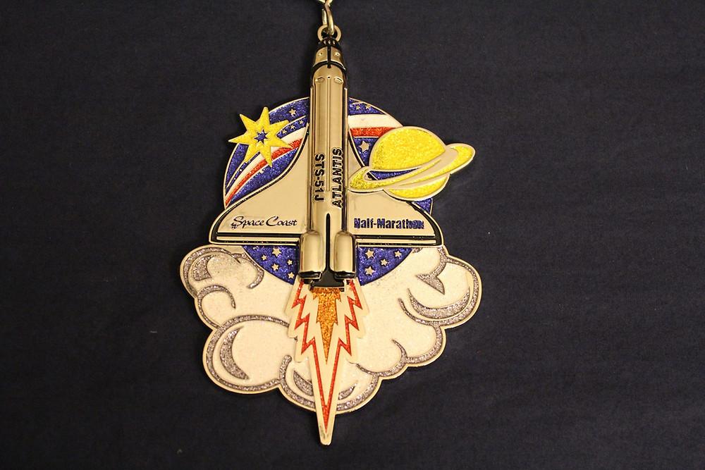 Space Coast Half Marathon 2017 medal