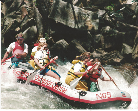 Dad guiding raft 1995.jpg