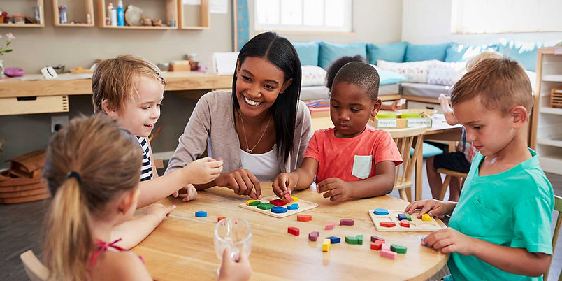 Daycare provider helping children with b
