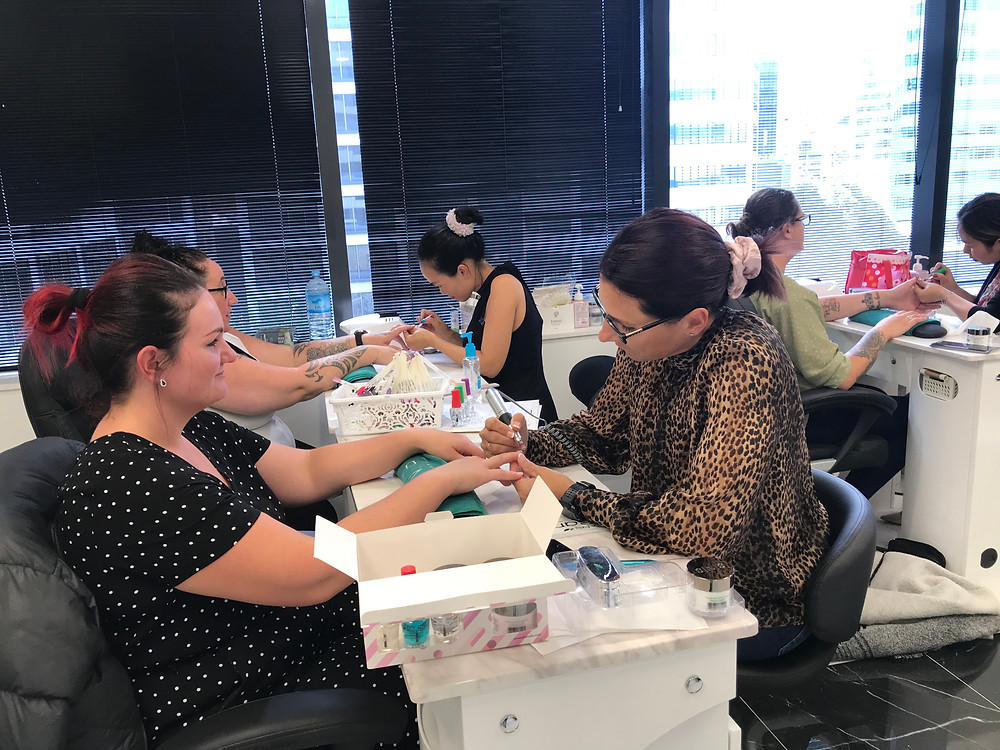 Students practise SNS Nails on live models