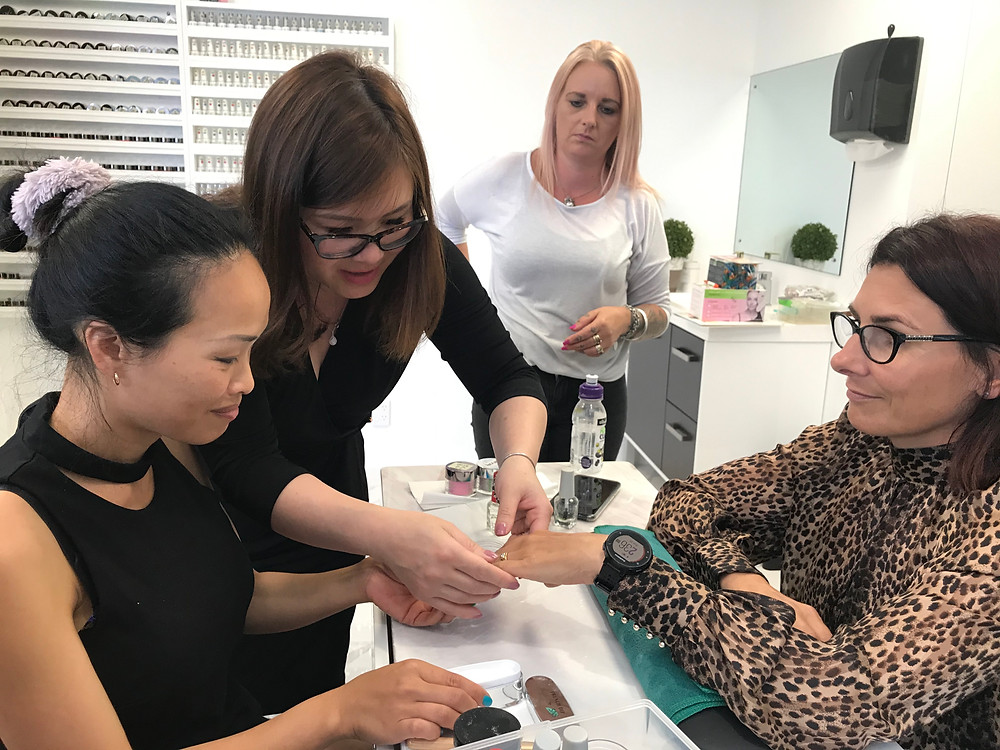 Students got instruction from our industrial trainer in the SNS Nail Training