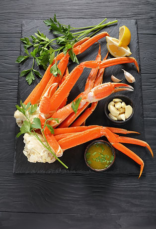 cooked Crab legs with melted butter, gar