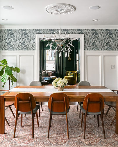 Bright and traditional dining room with wall paneling and wallpaper