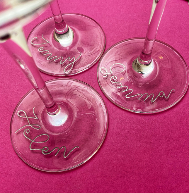 Hand engraved wedding wine glasses in modern calligraphy.