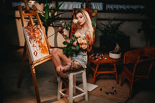 dark-room-with-artwork-and-blond-haired-painter-wi-7723ZCF.jpg