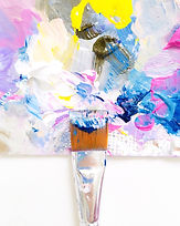 one-single-paintbrush-mixing-wet-paint-on-a-colorf-9AC4DQ5.jpg