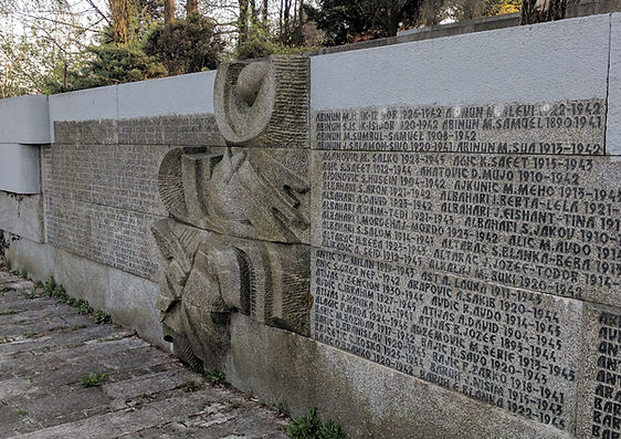 A photo of the memorial wall at the Vraca Spomenik Park in Sarajevo, Bosnia.