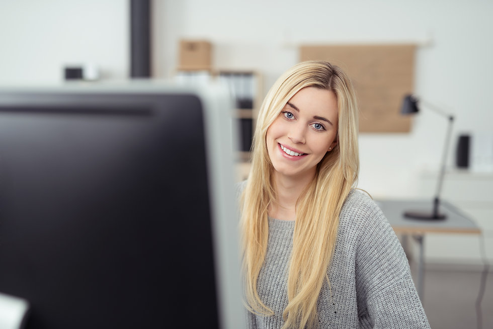 Close up Pretty Blond Woman Sitting at her Desk with Computer Monitor Inside the Office, L