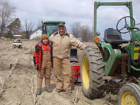 Henrys-Gardens-Martin-with-Tractor.jpg
