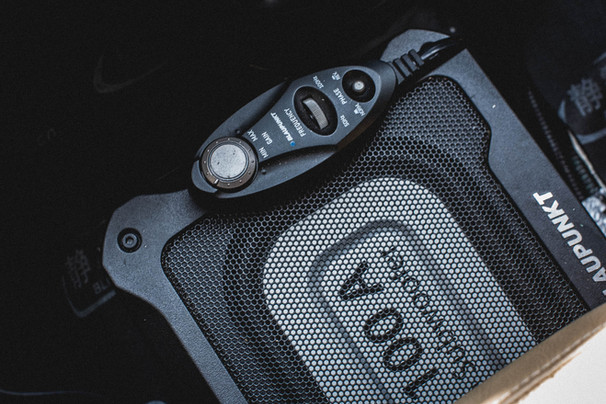 Sound system under front seat