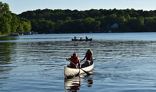 Campers canoeing on Lauderdale Lakes
