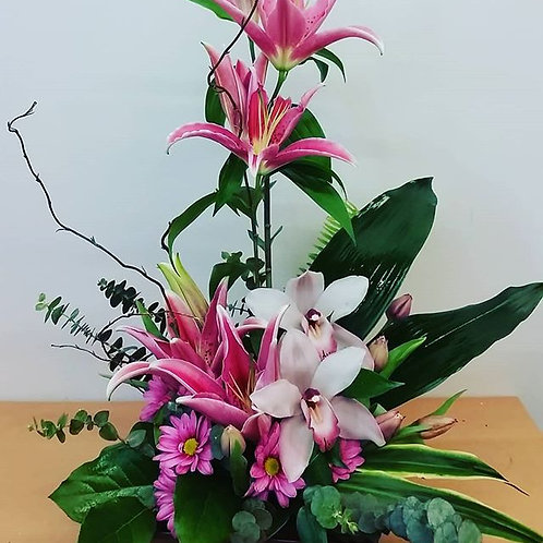 SA 15 (Pink Lilies with cymb orchid arrangment)