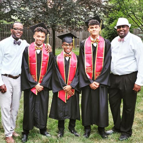 Diamond Foundation Founder and Secretary, Dr. Larnie Booker (left) acknowledges some of the graduating seniors of the NBA Kappa League Program.