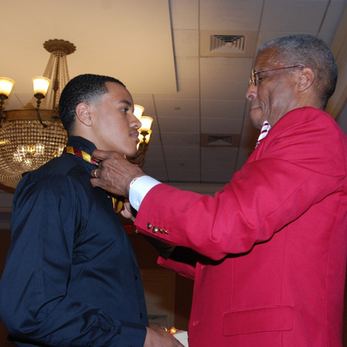 Diamond Foundation Chairman, Dr. Stephen Lawrence, performs the bow tie ceremony at the 2019 Dr. George A. Patterson Scholarship Luncheon