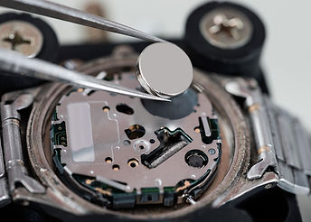 Image of watch battery being changed.