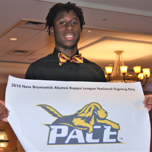 Adisa Phillips '19 announces his college selection of Pace University at the 2019 Dr. George A. Patterson Scholarship Luncheon.
