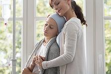 caregiver-hugging-sick-child-with-cancer