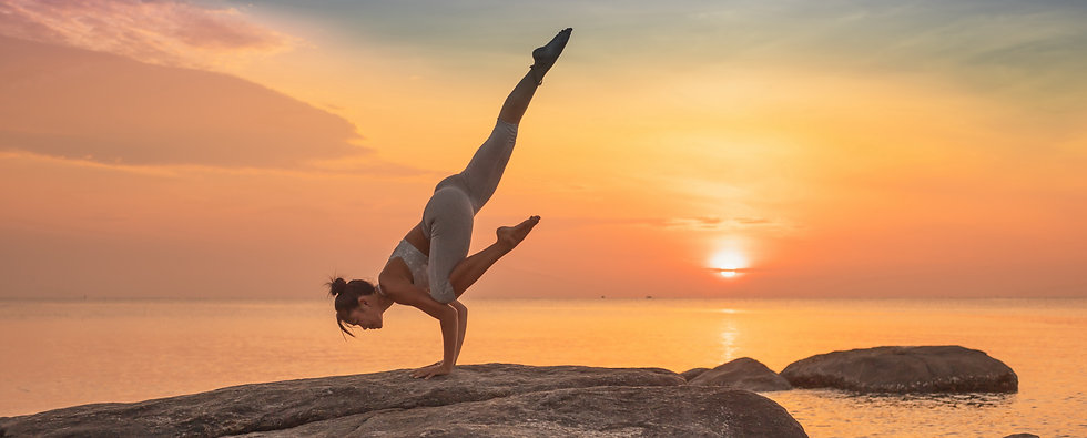girl-practicing-yoga-rock (1).jpg