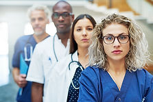 thoughtful-team-of-doctors-looking-at-ca