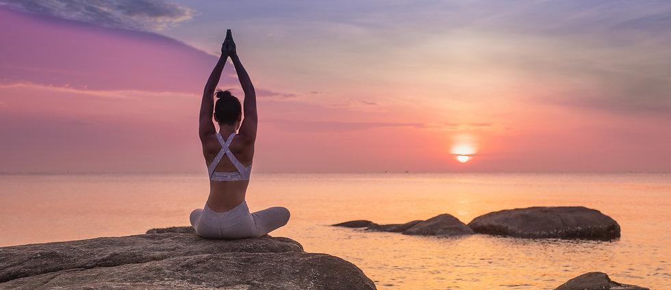 girl-practicing-yoga-rock.jpg