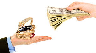 Hand hold jewelry and another holding money