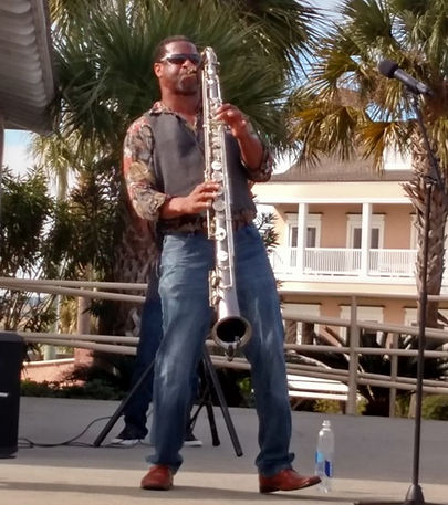 Mike at Mary Ross Park playing the sax p