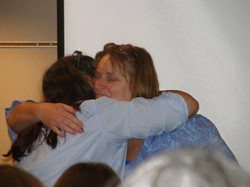 Kim Kyle receiving a grateful hug.