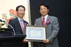 Xinle Ma and Ambassador Sun Guoxiang