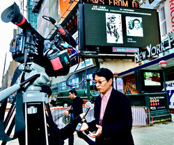 Xinle Ma at Times Square's giant LED Scr