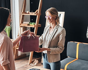 Australian health and lifestyle influencer receiving a gift from Australian business CEO, at an influencer campaign shooting day in Sydney.