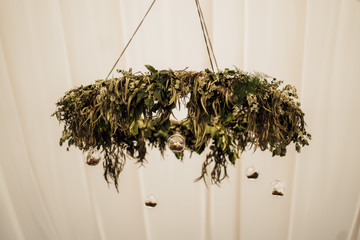 hanging foliage hoop from marquee at burloes hall hertfordshire