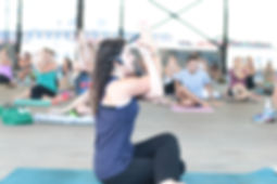 Firecracer Yogi, Amanda Credeur, teaching at Crescent Park in New Orleans, LA