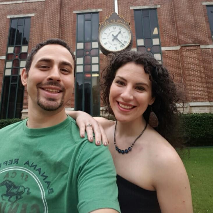 Amanda & Stephen at Loyola University where it all began, standing in front of the clock donated to campus by their graduating class.