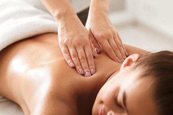 young-woman-enjoying-therapeutic-neck-ma